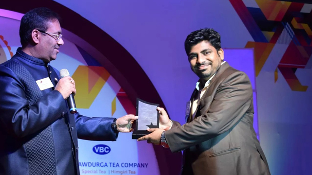 Vikram Sinha of We Care Pest Control receiving award of excellence
